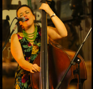 Liz Frencham playing the double bass and singing